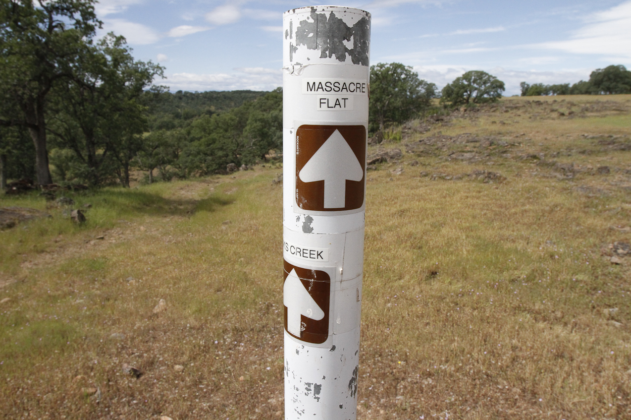 Pole marking trail to Massacre Flat Primitive Camping Area in the Sacramento River Bend Outstanding Natural Area near Red Bluff, California. Photo by Clay Duda.