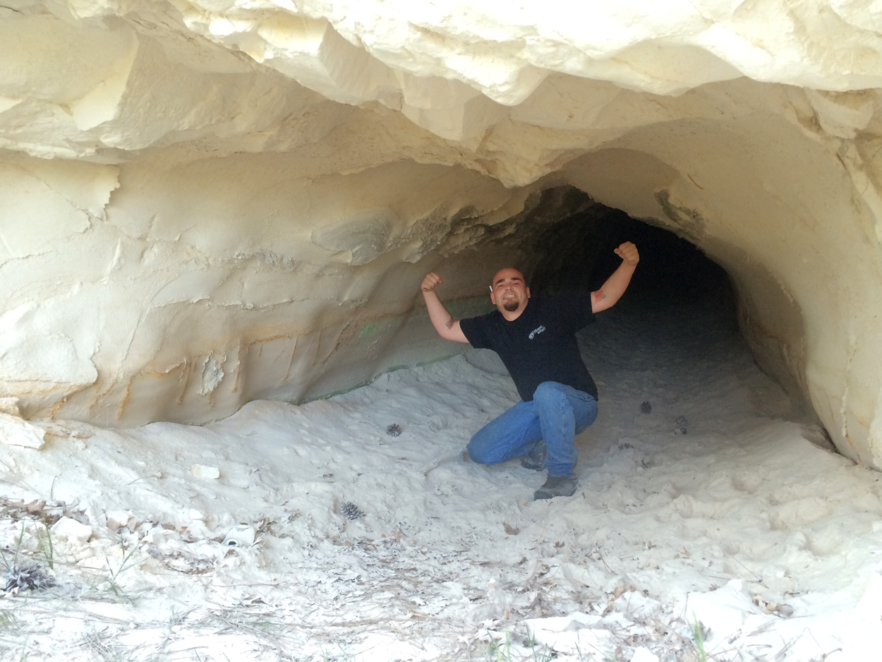 Jimmy explores a diatomaceous  cave near Hat Creek. Photo by Clay Duda.