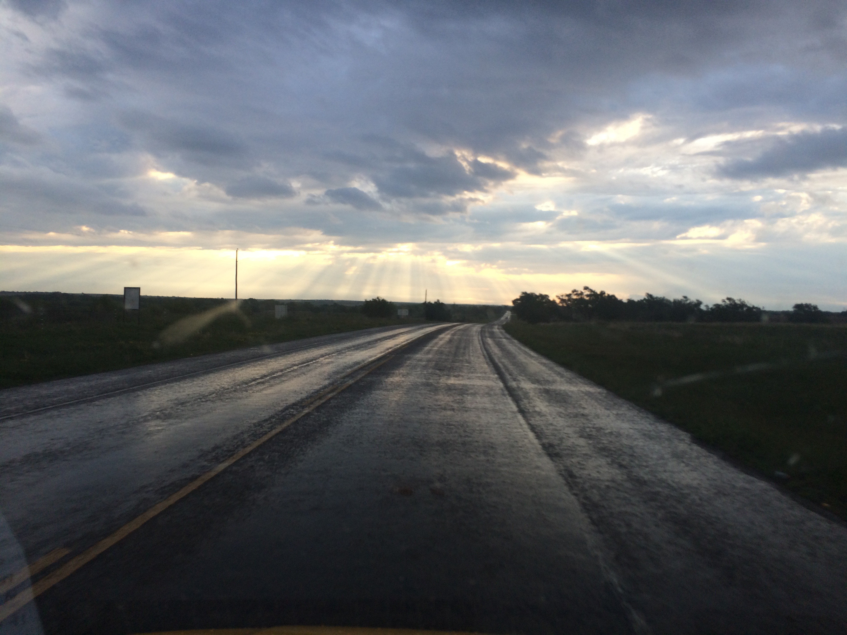 Sunshine streaks through the clouds early morning on the Texas panhandle. Photo by Clay Duda.
