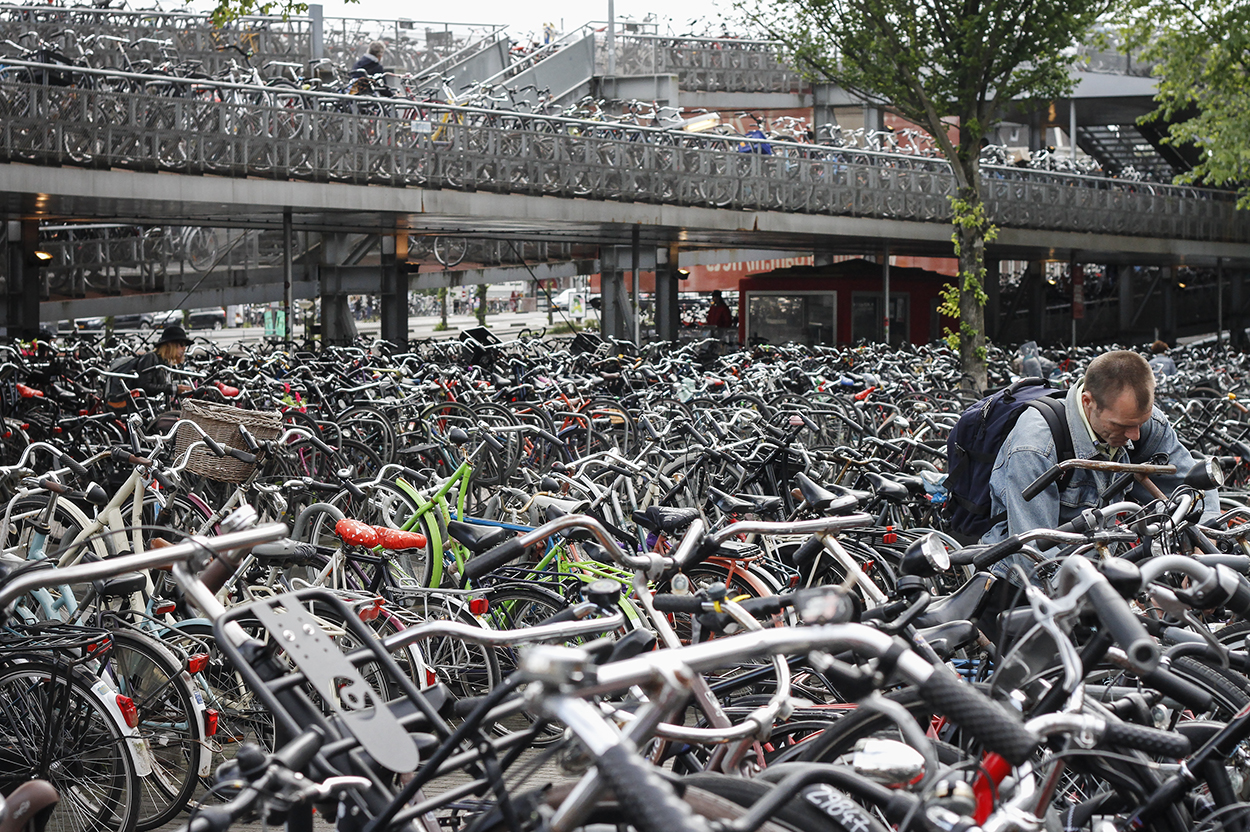 Tons of bikes parked at Amsterdam's Central Station. Photo by Clay Duda.