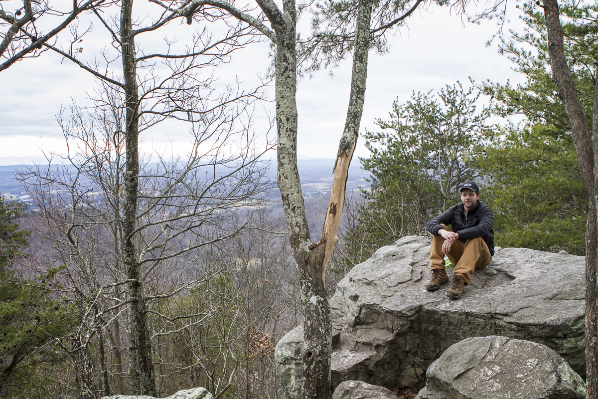 Clay Duda sits atop House Mountain, the highest point in Knox County, Tennessee. Photo by Melissa Duda.
