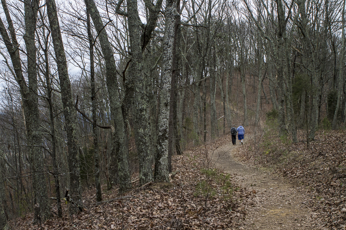 A couple walks along the Crest Trail on House Mountain in Knox County, Tennessee near the town of Corryton. Photo by Clay Duda.