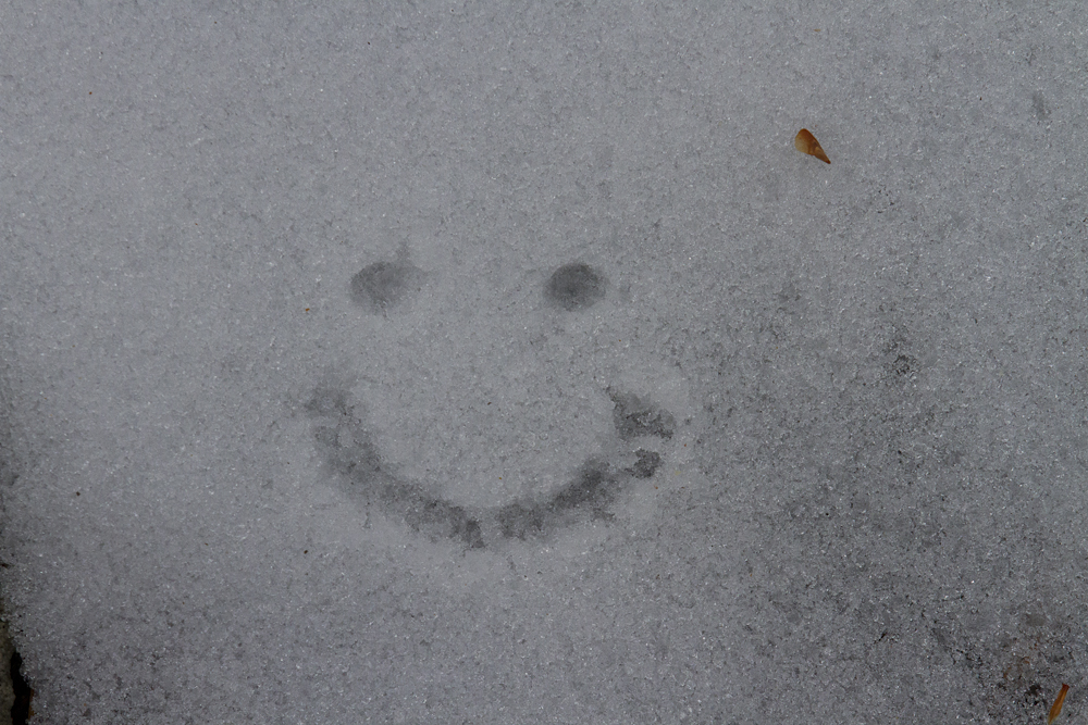 Smiley face in the snow. Photo by Clay Duda.