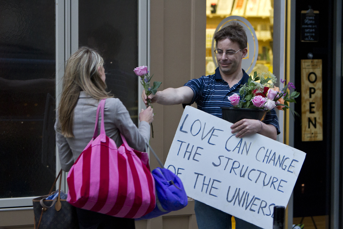 A guy gives out free roses in downtown Knoxville during the first day of performances at Big Ears 2016. Photo by Clay Duda.