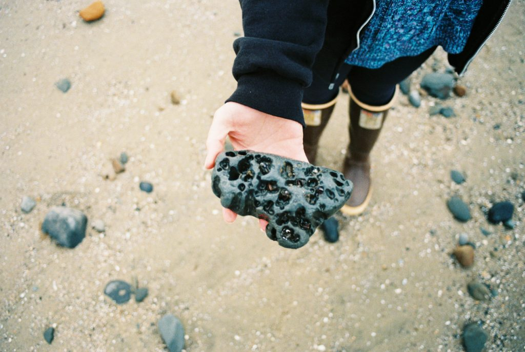 Searching for agates on Moolack Beach, Oregon. Photo by Clay Duda.