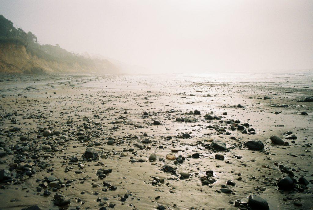 Where the rocks meet the sea. Olympus OM-2 // 28mm f3.5 // Lomography 400