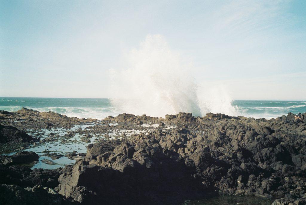 Waves crash over the rocky coastline at Cape Perpetua, Oregon. Photo by Melissa Duda.